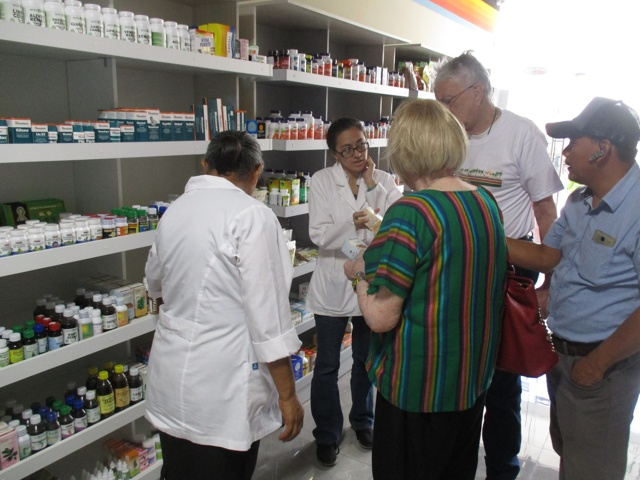 Staff kindly showing us the Pharmacy during the tour