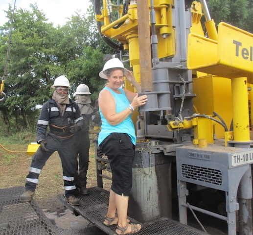 Holly standing on drill