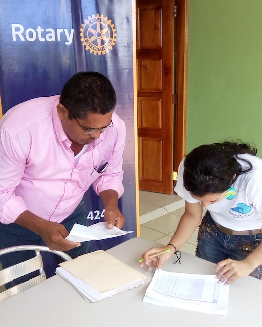 Ruth and leader from Rivas going over list