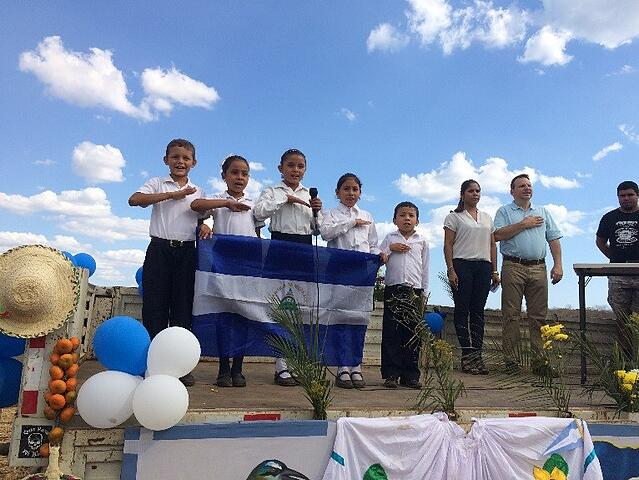 Children of Villa el Carmen sing National Anthem