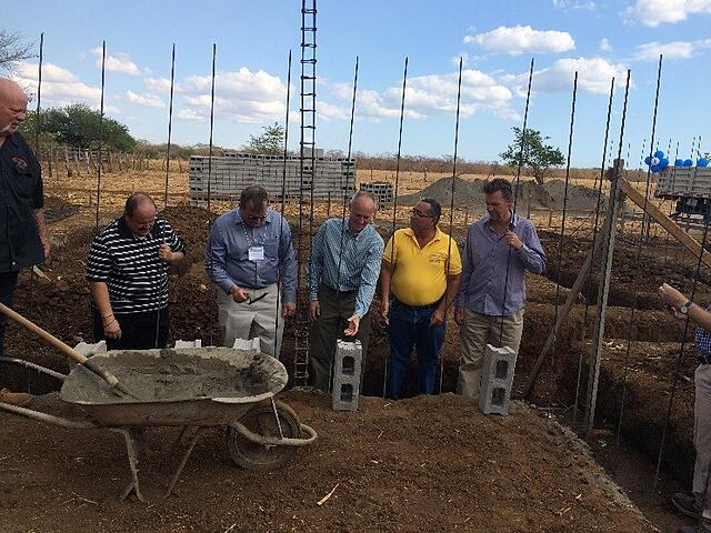laying the first bricks at Robert Clemente Clinic III